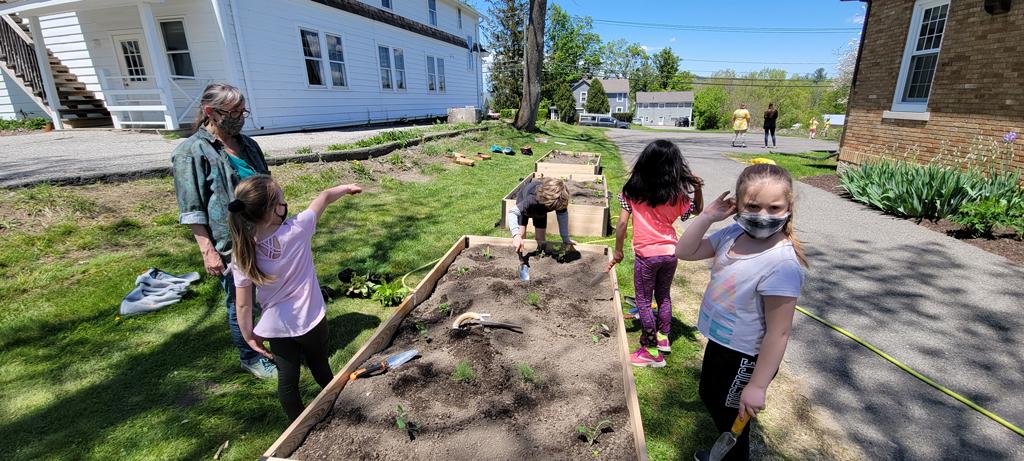Second graders plant vegetables