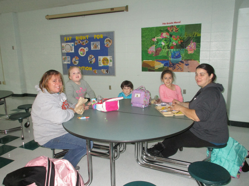 Parents and students eating lunch at the parent lunch celebration