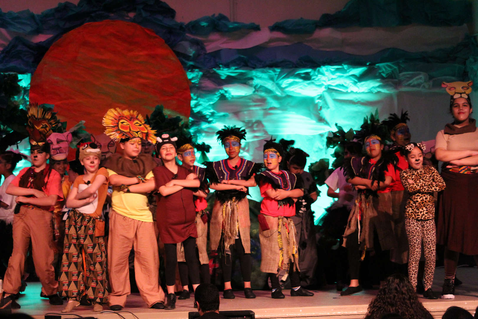 Cast on stage singing Hakuna Matata