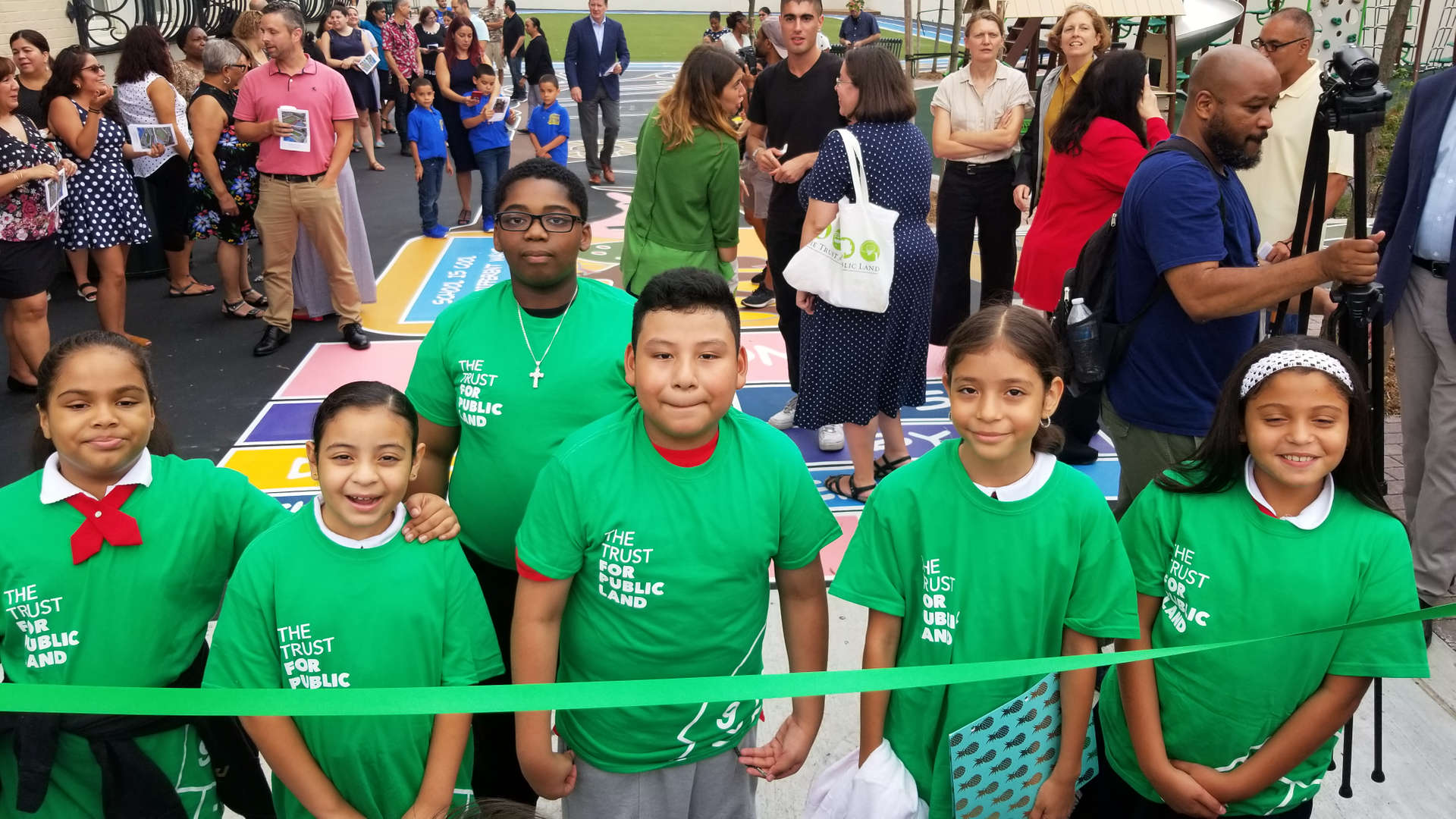students at the ribbon cutting ceremony of the playground