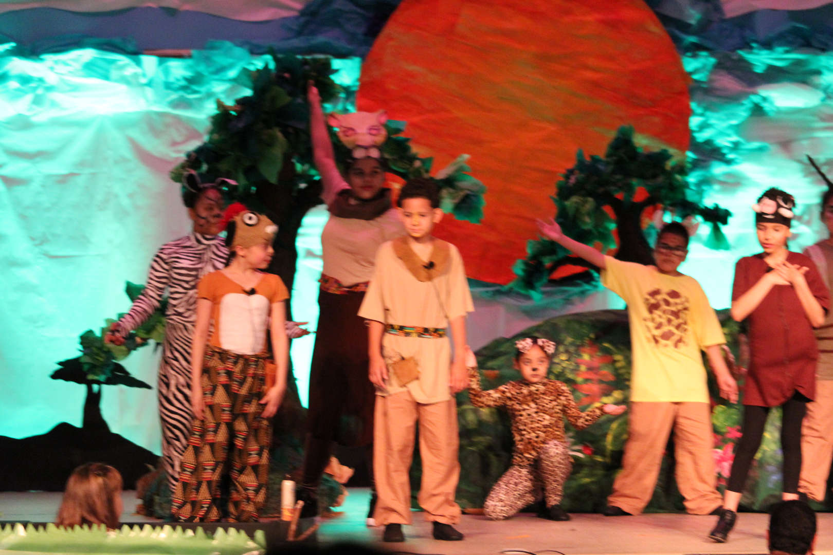 Young Simba, Pumba and Timon on stage