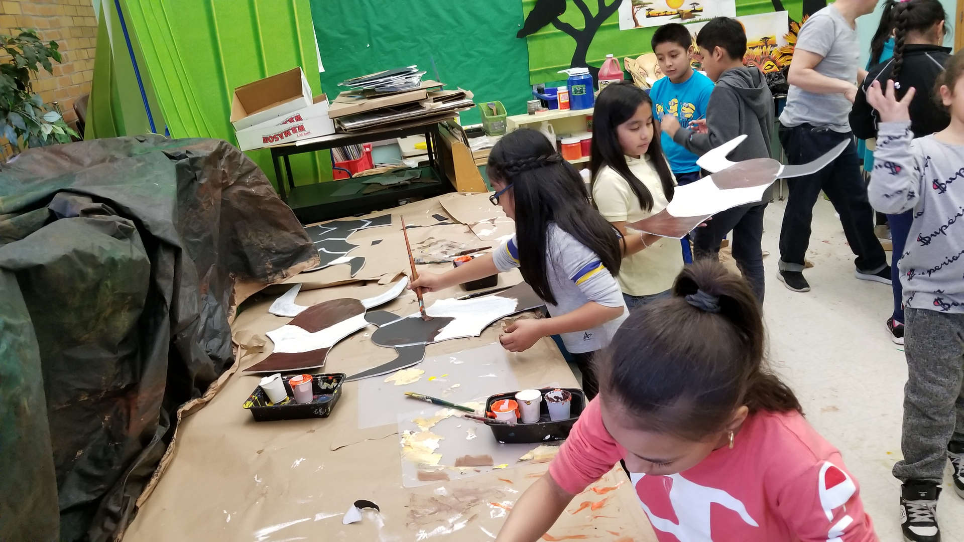 Students painting masks for the Lion King Kids Musical