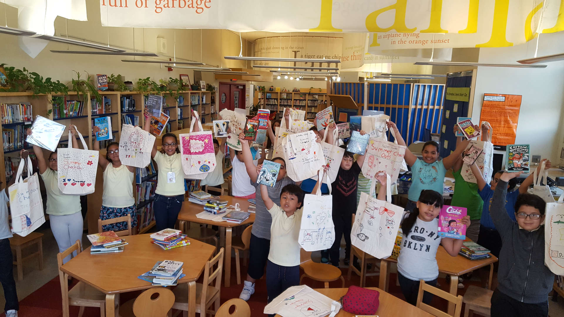 Students displaying their personalized tote bags