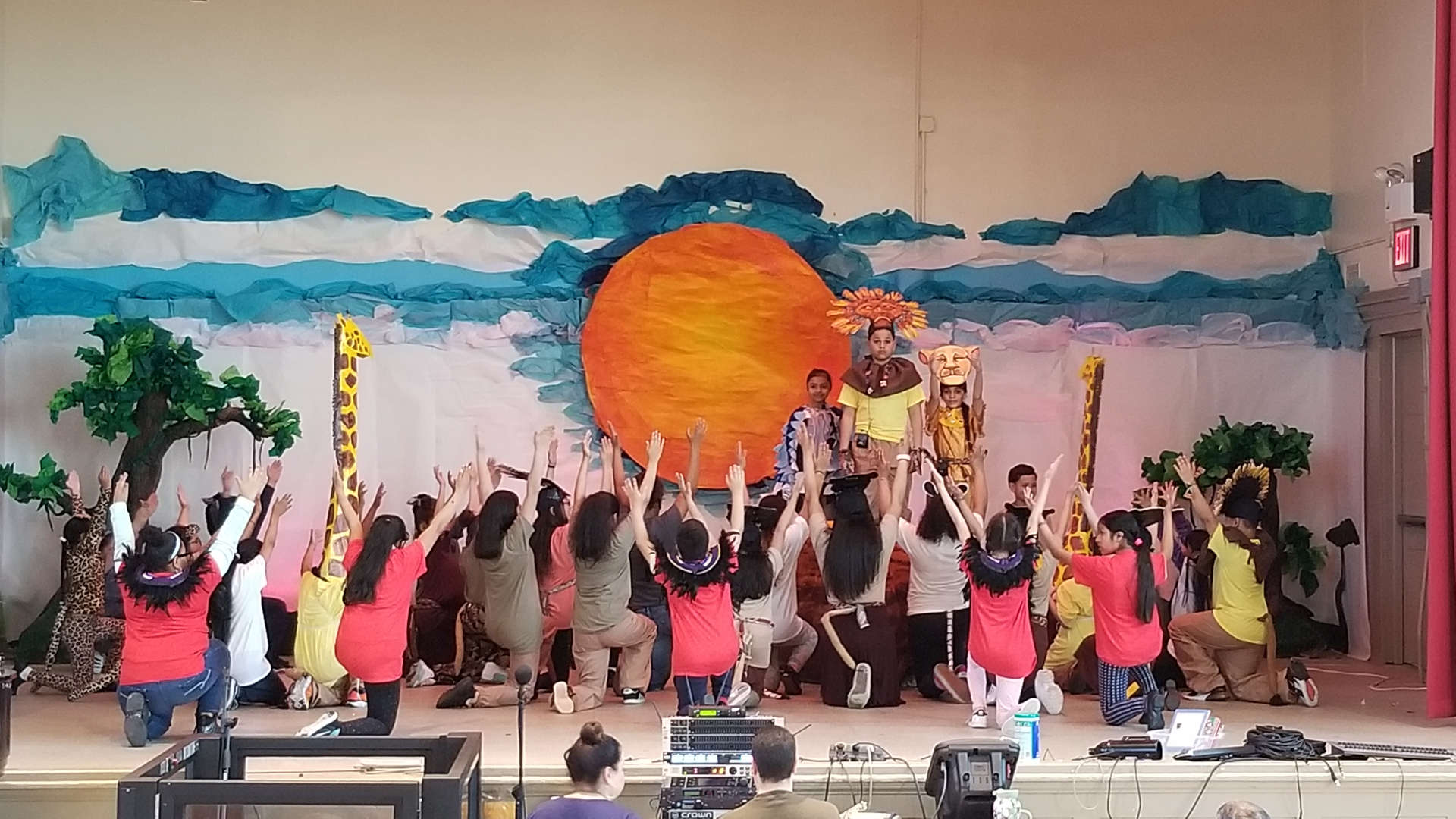 Students rehearsing Circle of Life in the auditorium