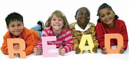 children holding abc blocks