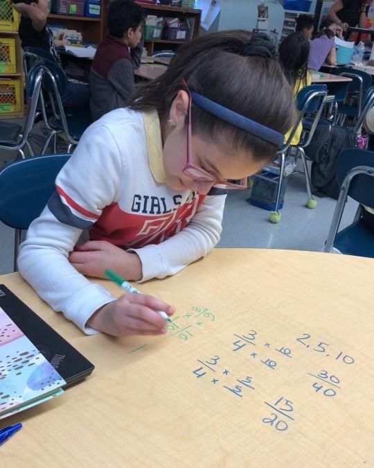 Student solving math problem