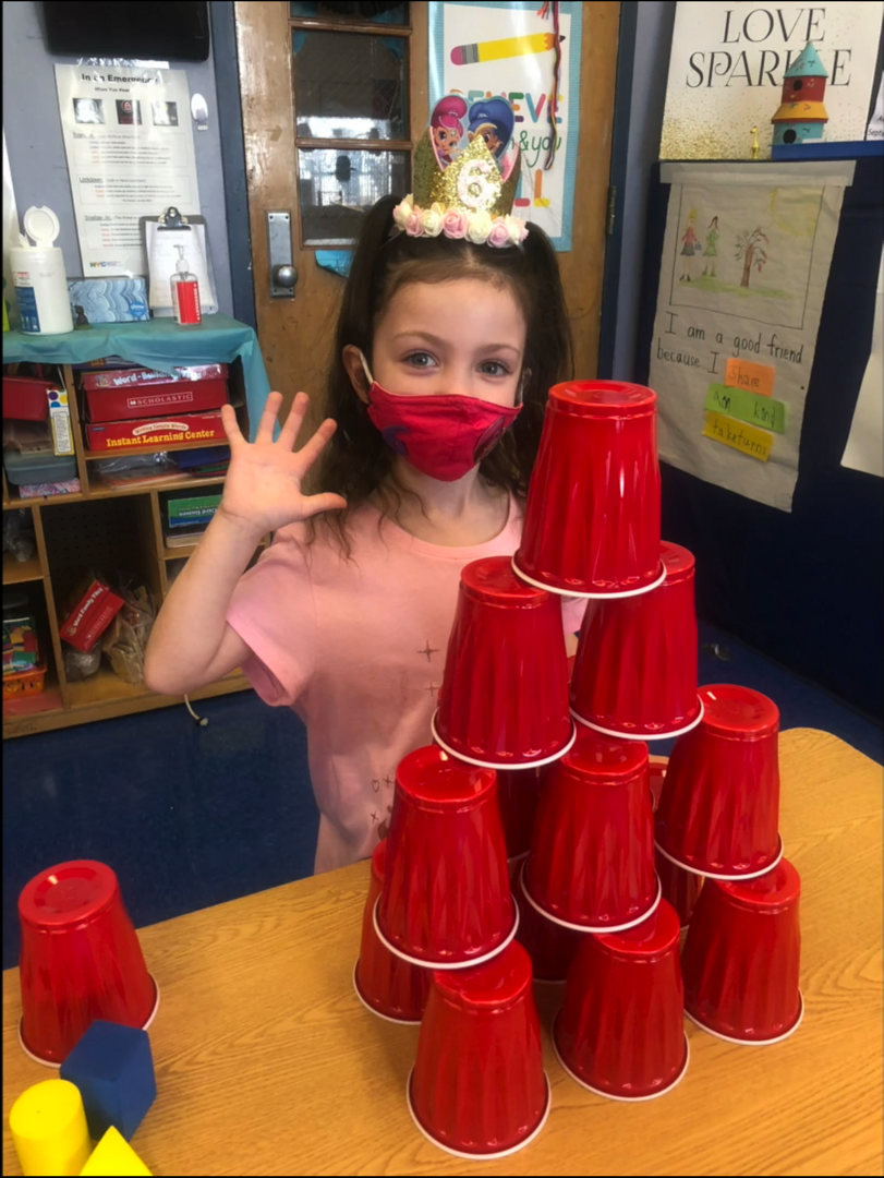 Student stacking cups