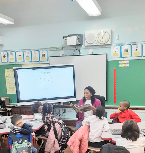 Parent Reading Aloud to Students in Classroom