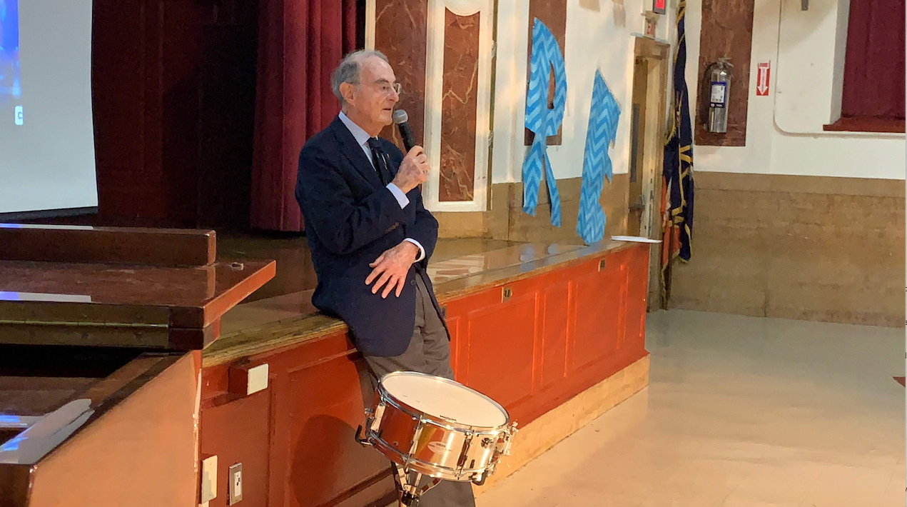 Principal For a Day, Mr. Peter Malkin Leaning Against Auditorium Stage