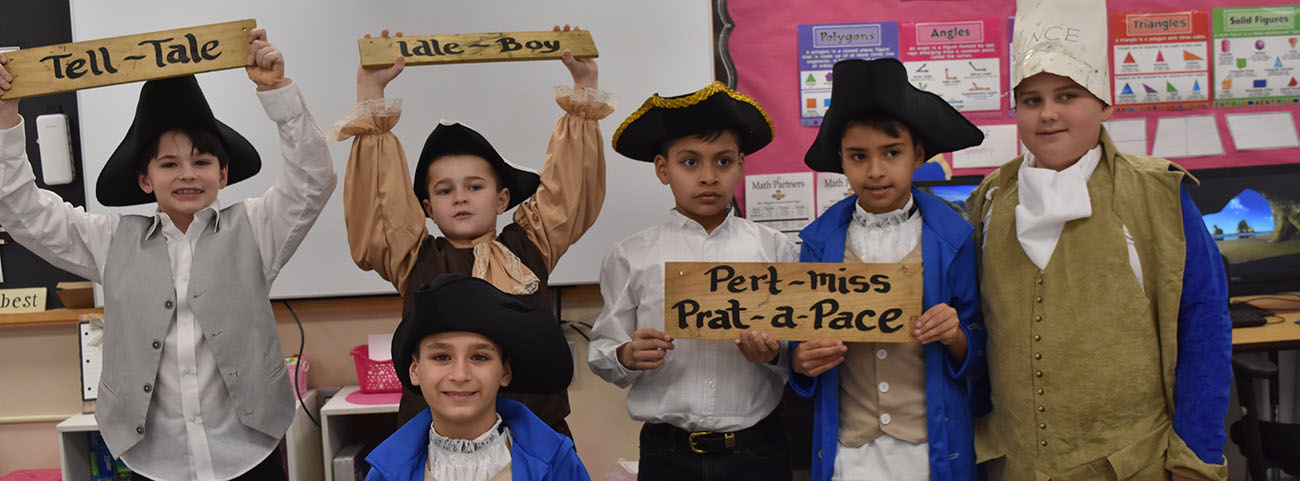 Group of boys show off old-fashioned signs