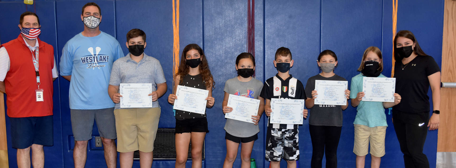 6 students with awards pose for picture with 3 teachers