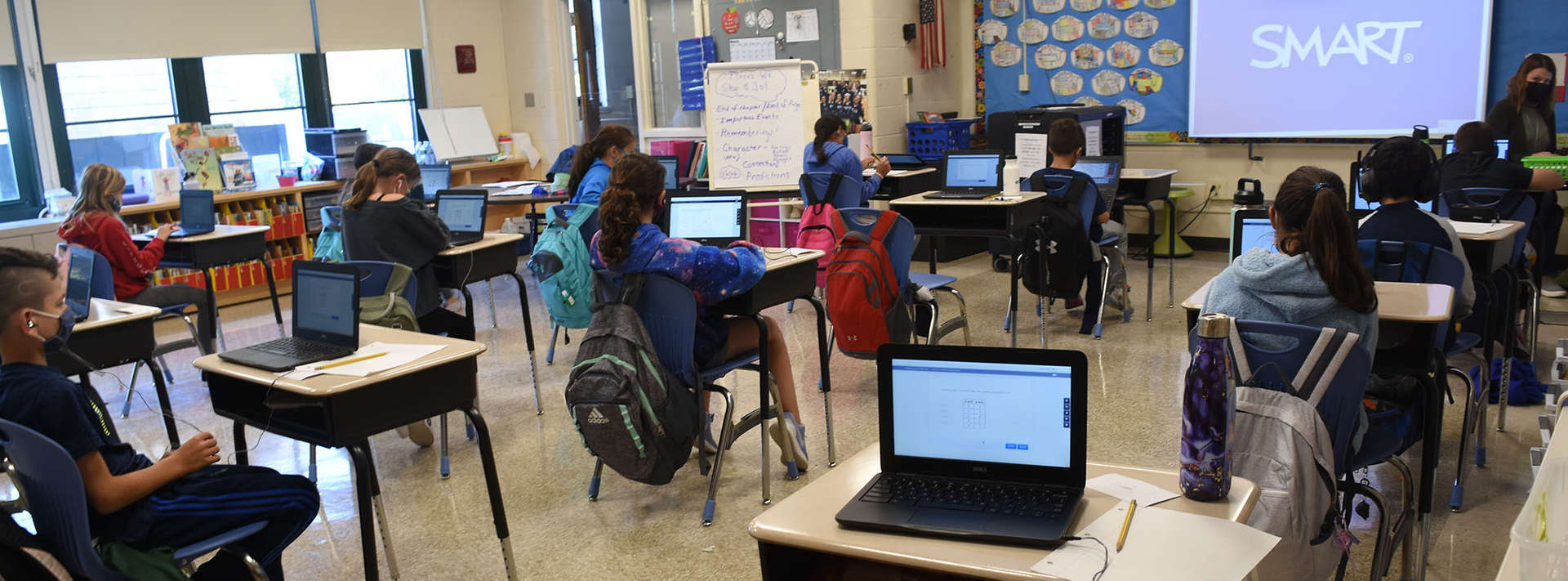 4th grade class work on laptops at their desks