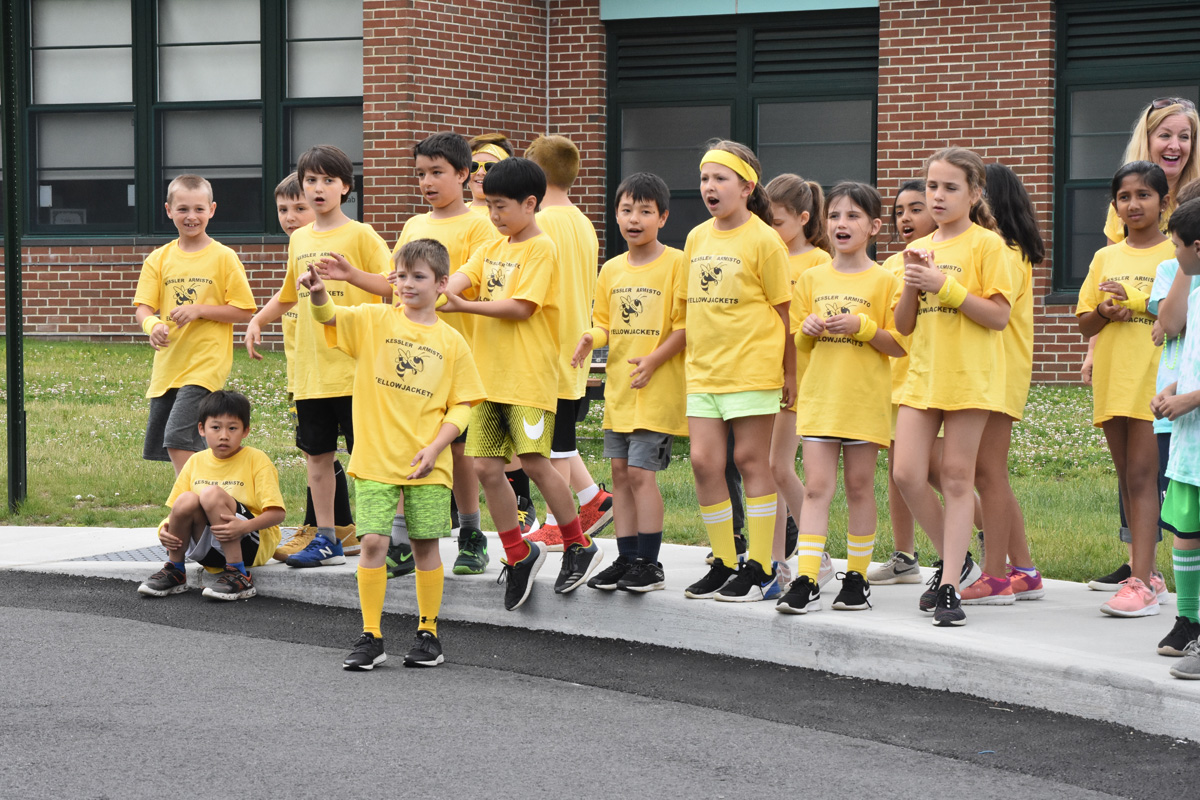 yellow team cheers from sidelines
