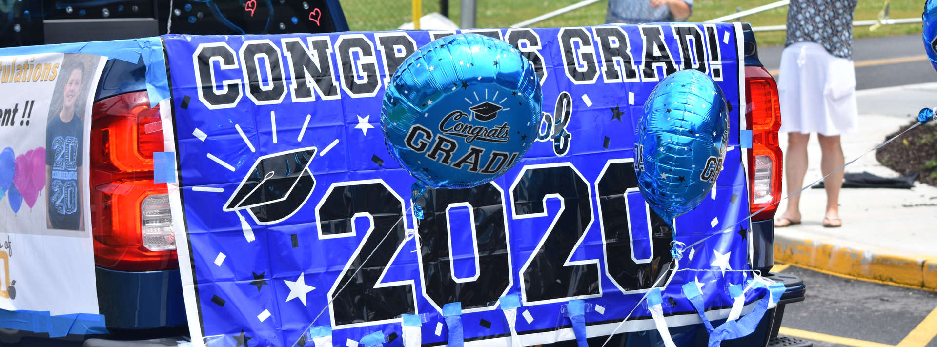 Class of 2020 banner on back of car