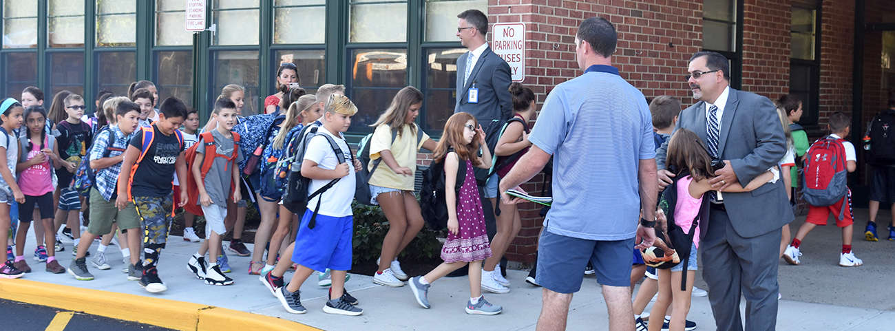 Children arrive for the first day of school
