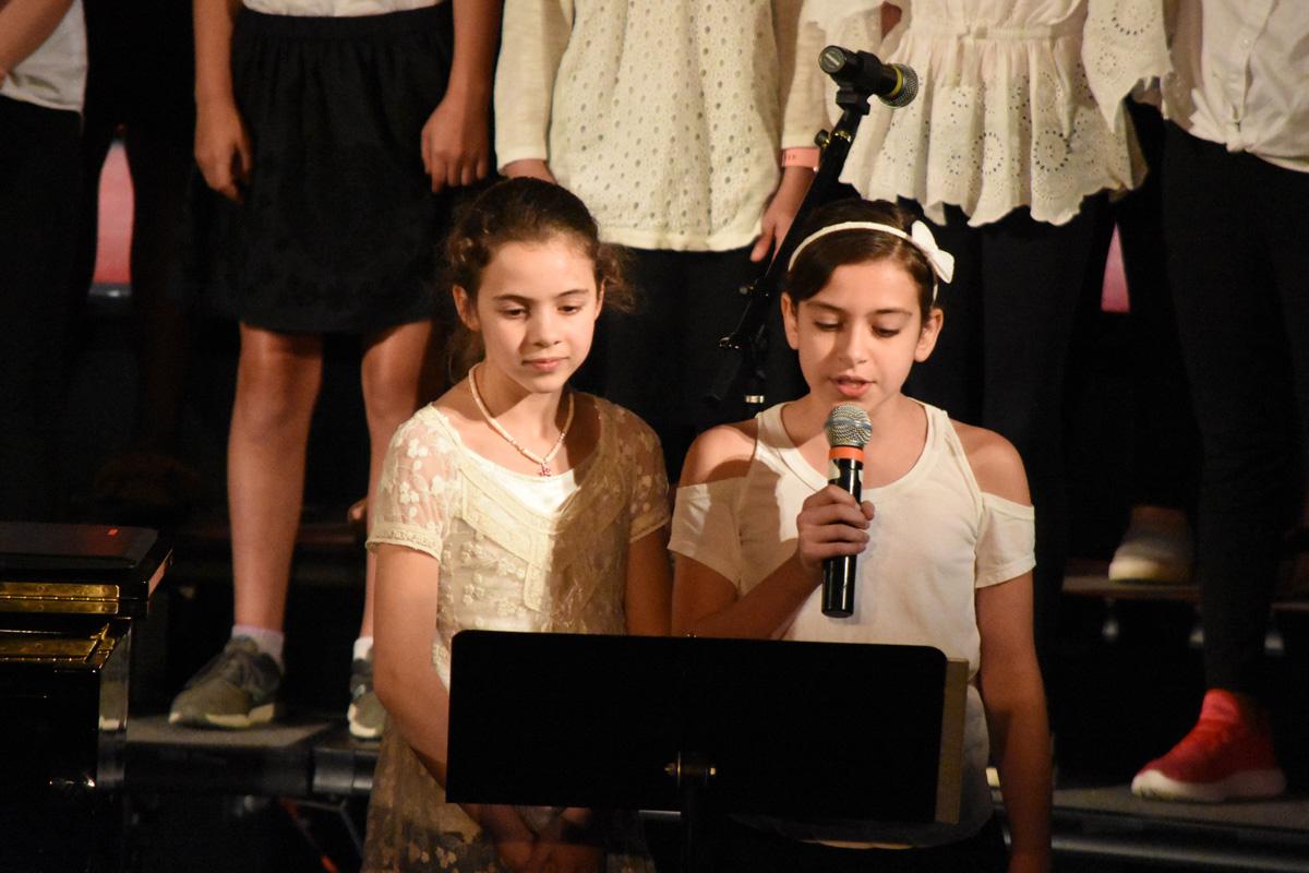 two girls sing
