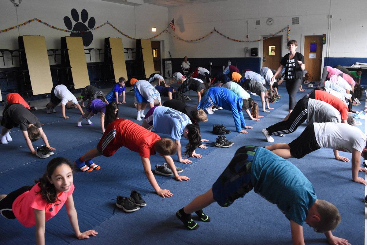 Group of students doing yoga