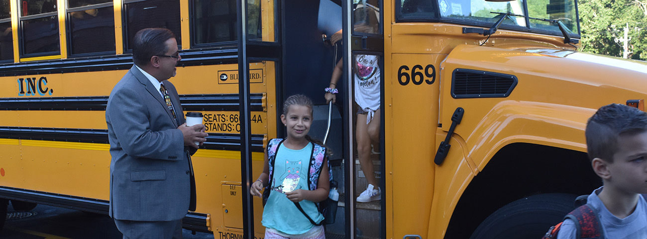 Principal greets students on bus