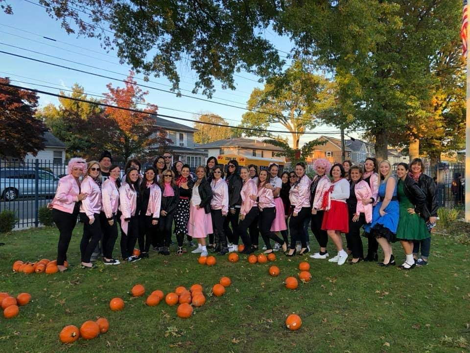 Teachers and staff dresses in 1950's attire for Halloween