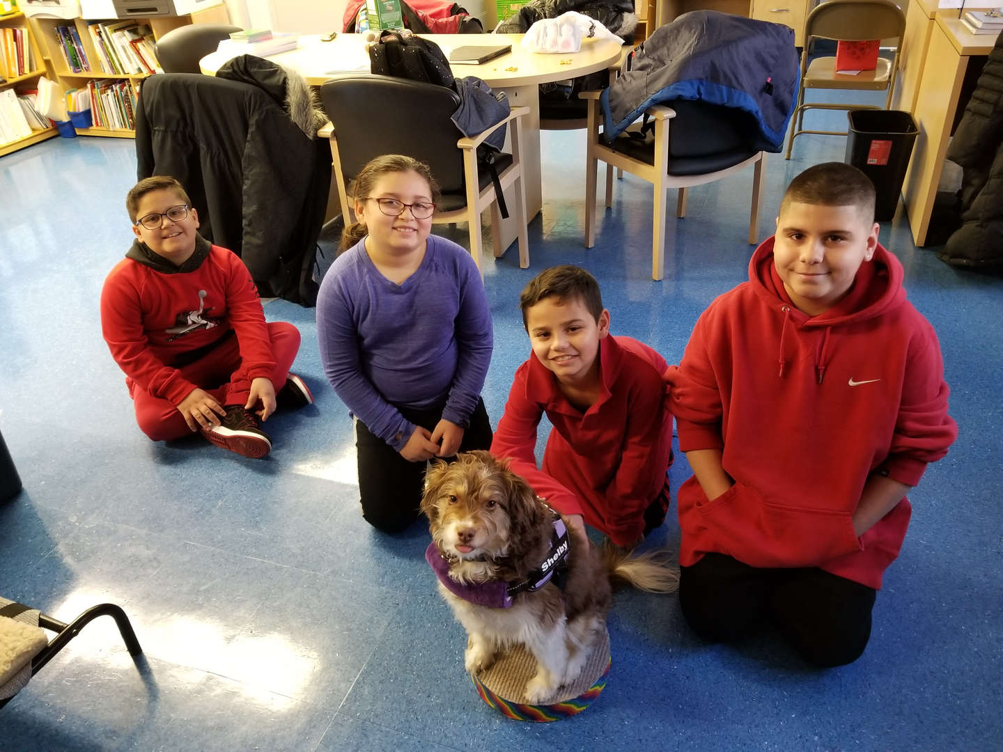 PS 38 students with our comfort dog Shelby.
