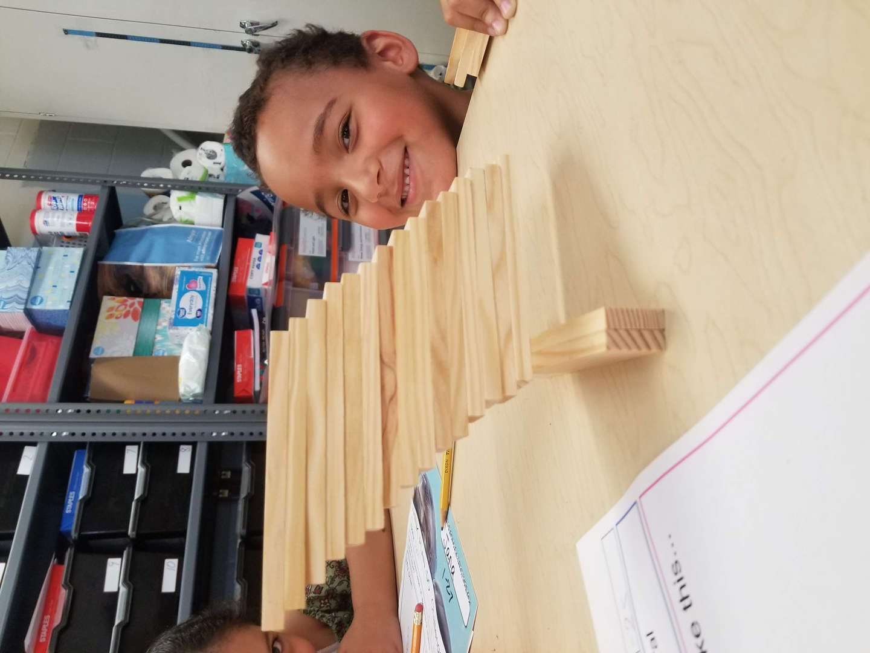 School children building a tower with Kapla Blocks