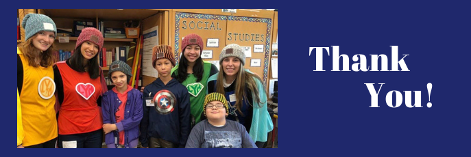 Thank You! - Three students with four adults smiling wearing donated hats.
