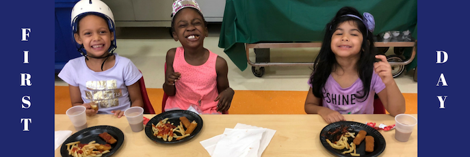 First Day - Three students smiling at table eating lunch