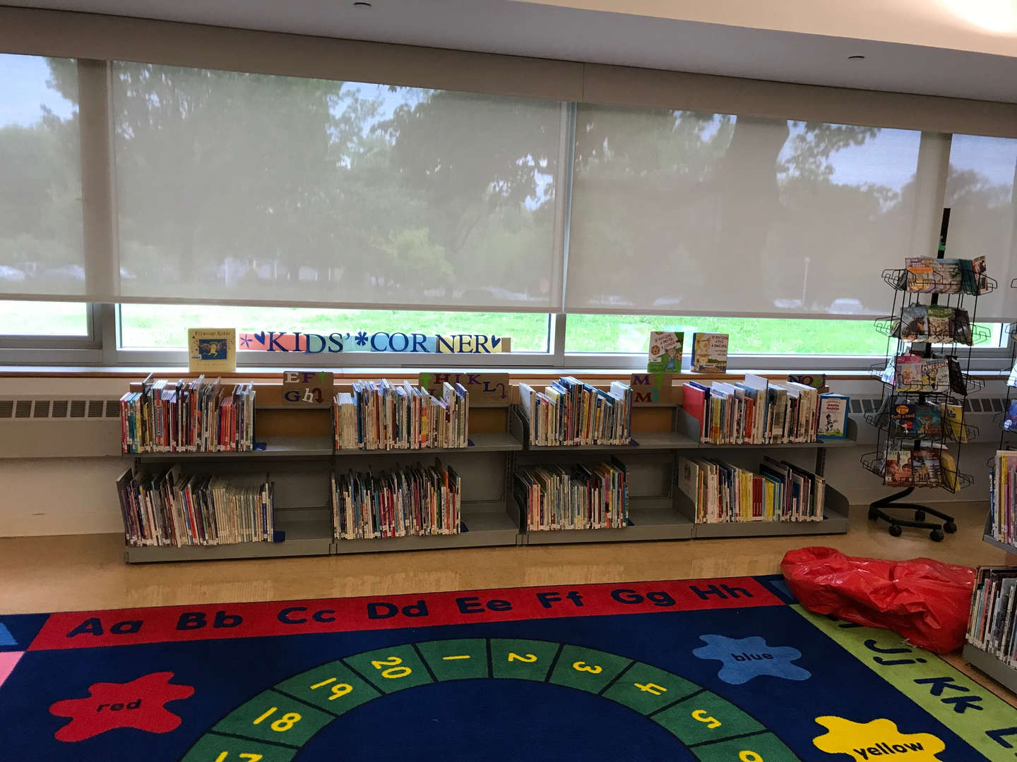 Windows with Kids' Corner posted on the sill and elementary books below.