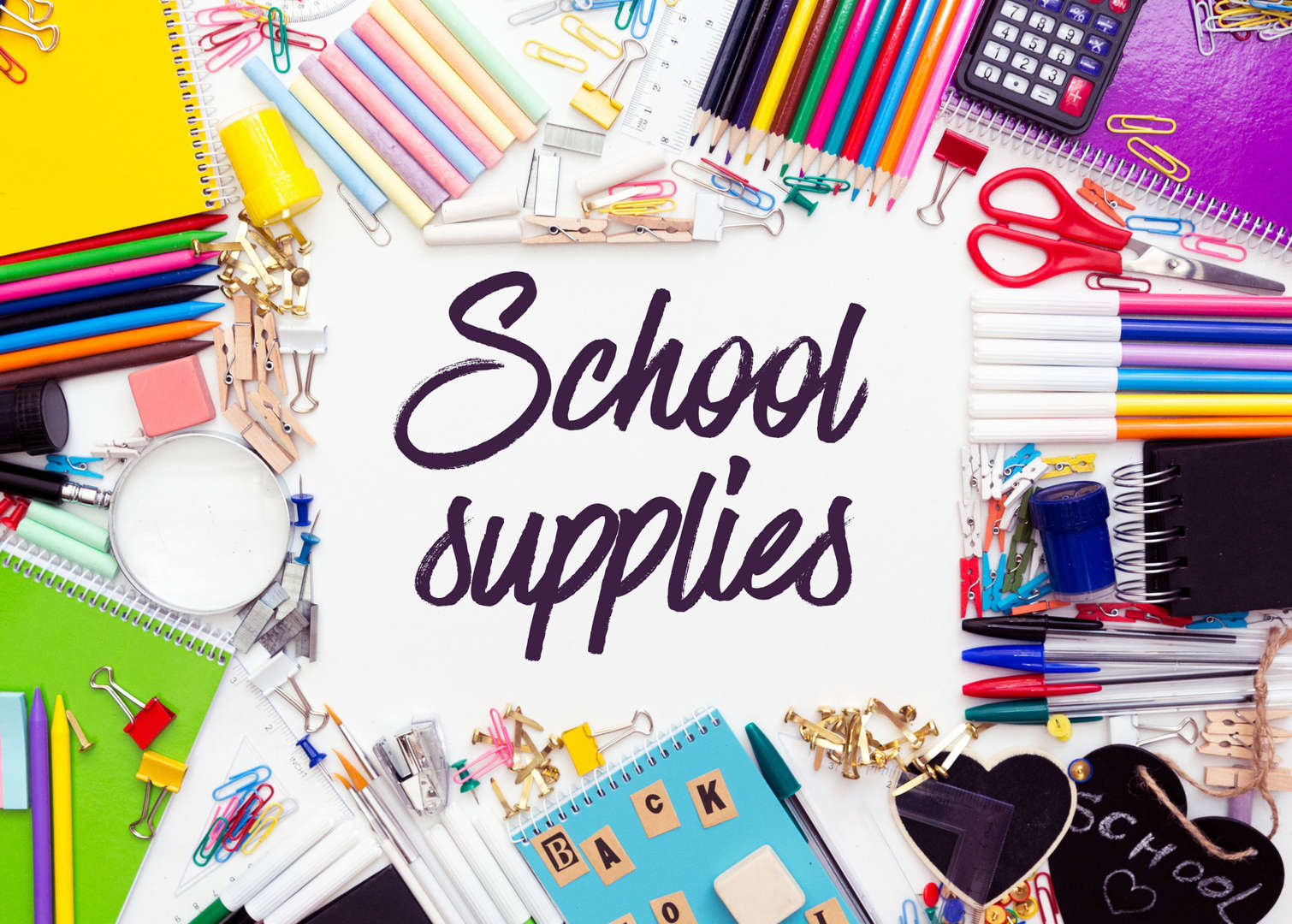 School supplies surrounded by colorful books, pencils, crayons, and notebooks