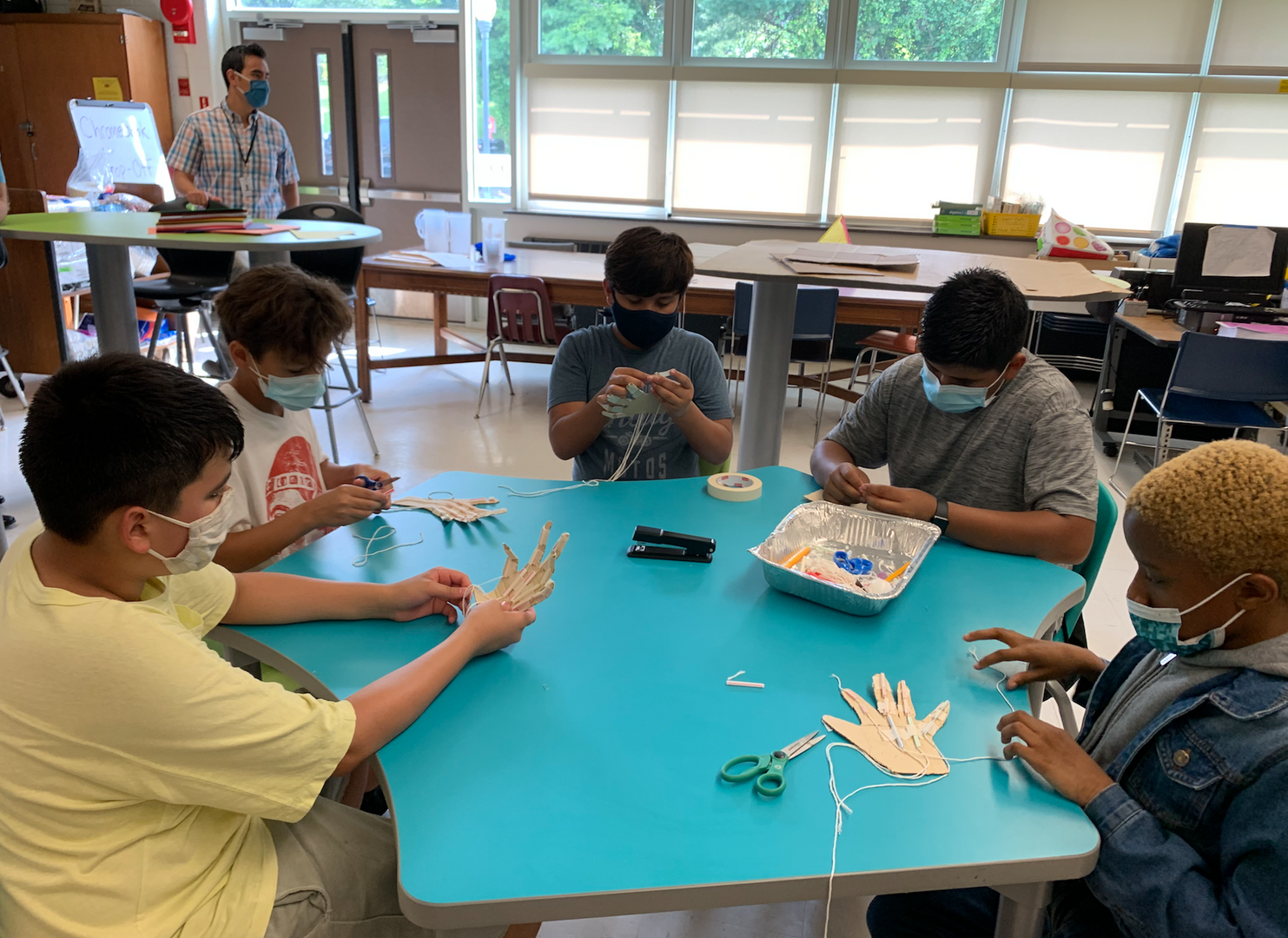 Students making a mechanical hand