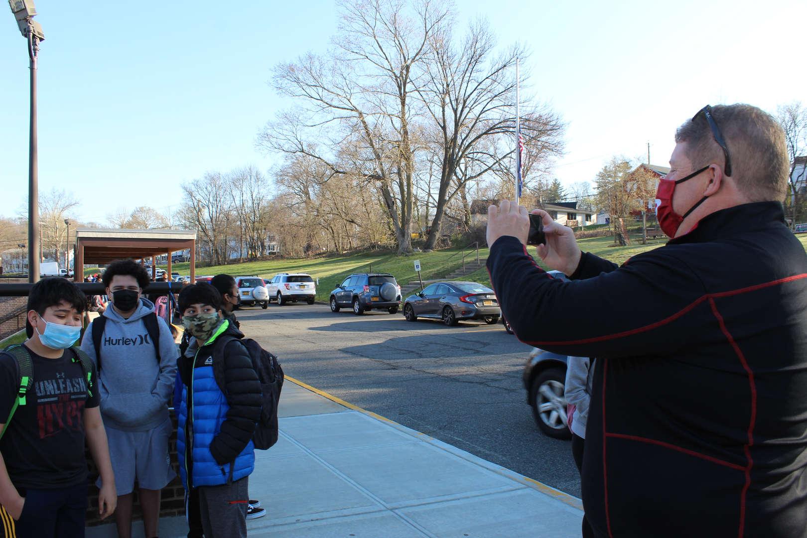 Principal taking a photo of students