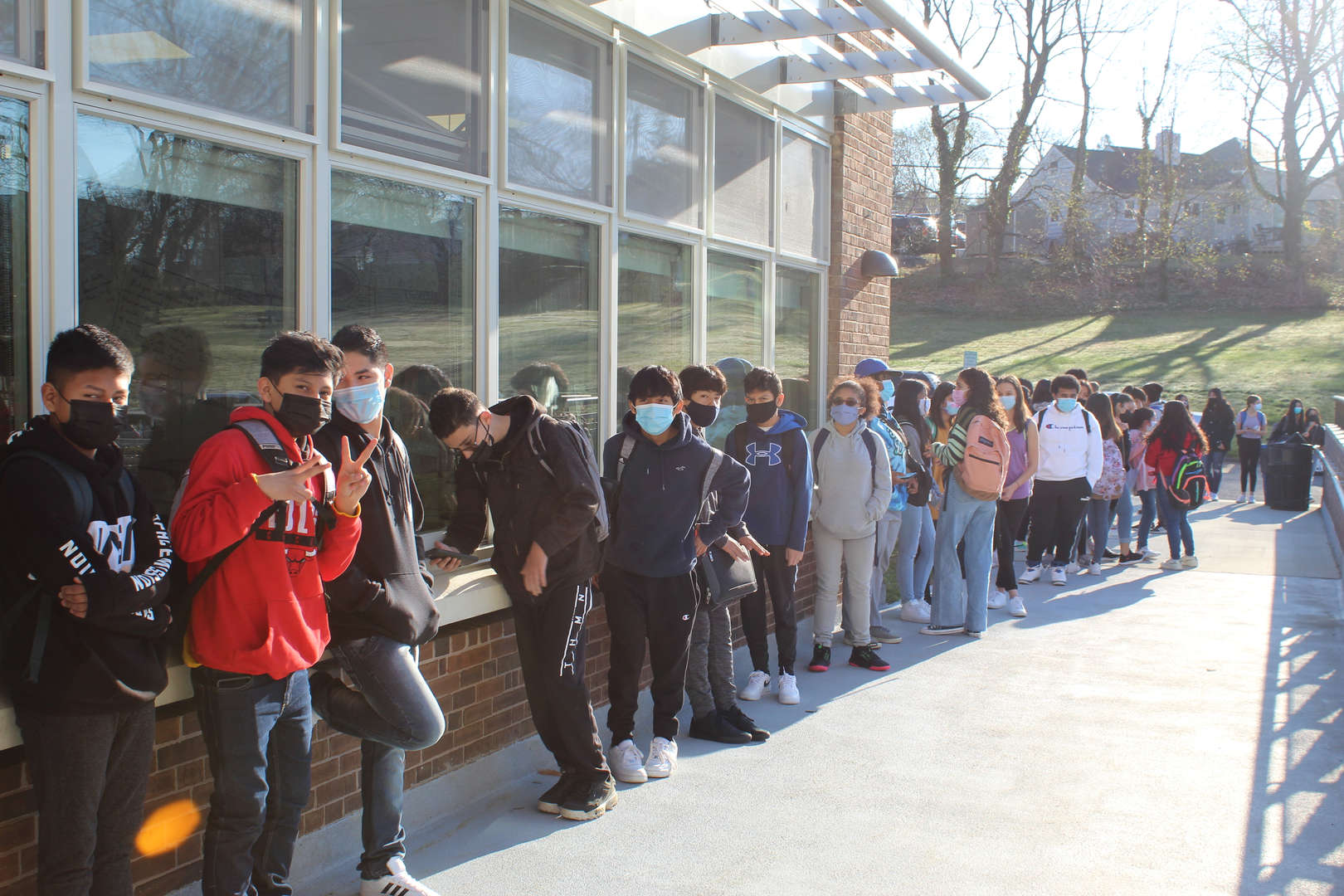 Students waiting outside to go into school building