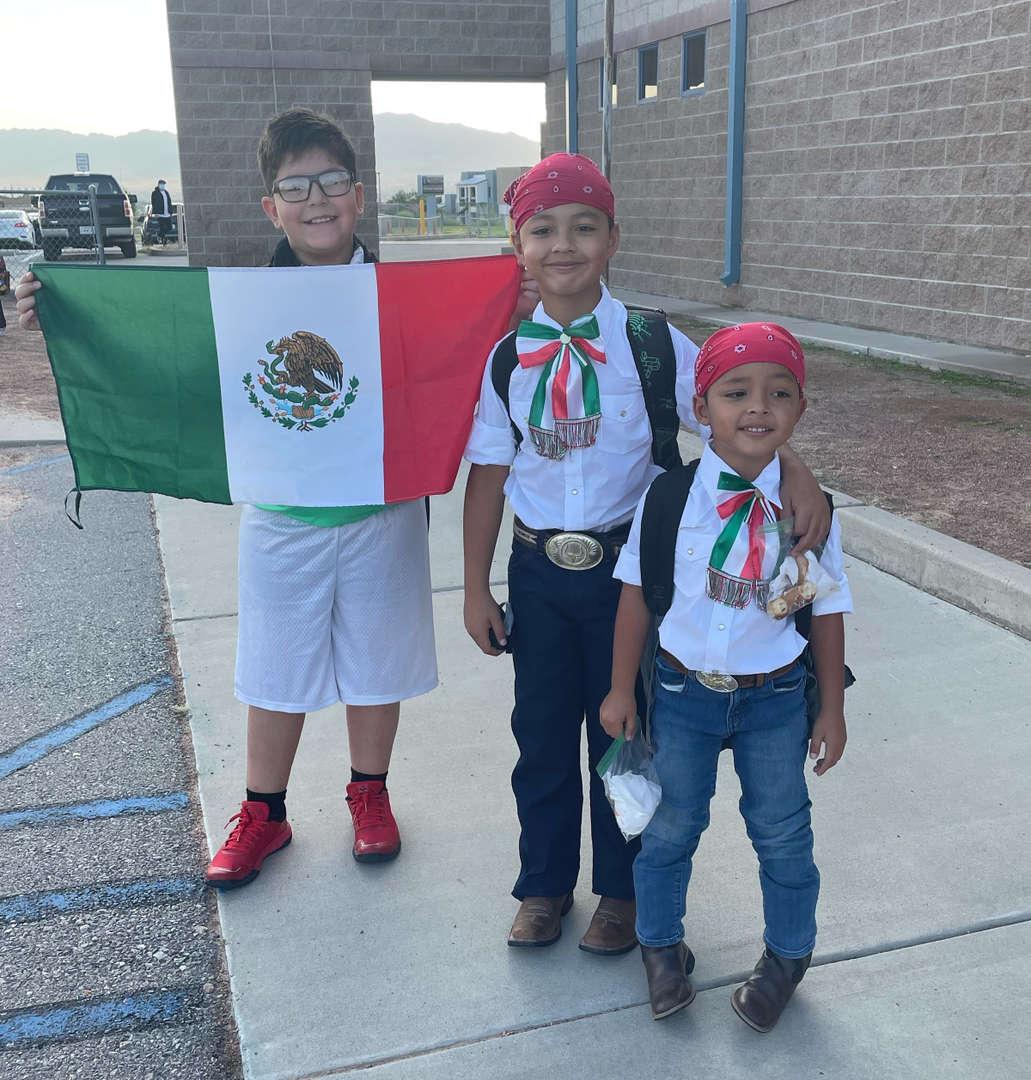 three students posing