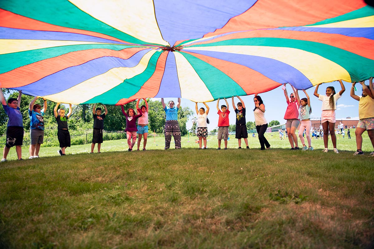 Students under parachute at Field Day