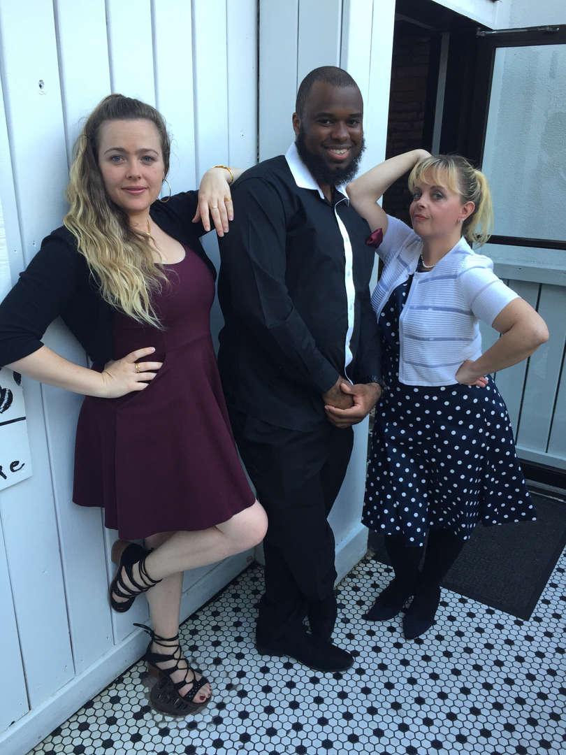 Three teachers posing in formal wear
