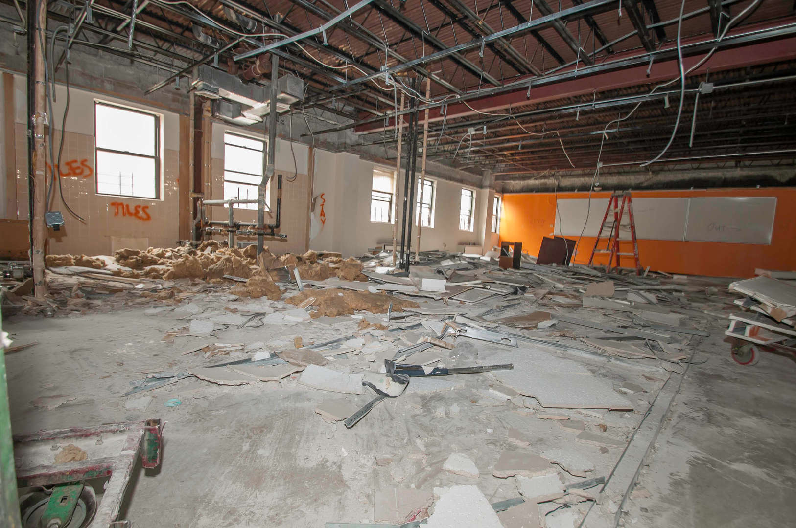 Interior room fully demolished ceiling and walls and preparing for new construction