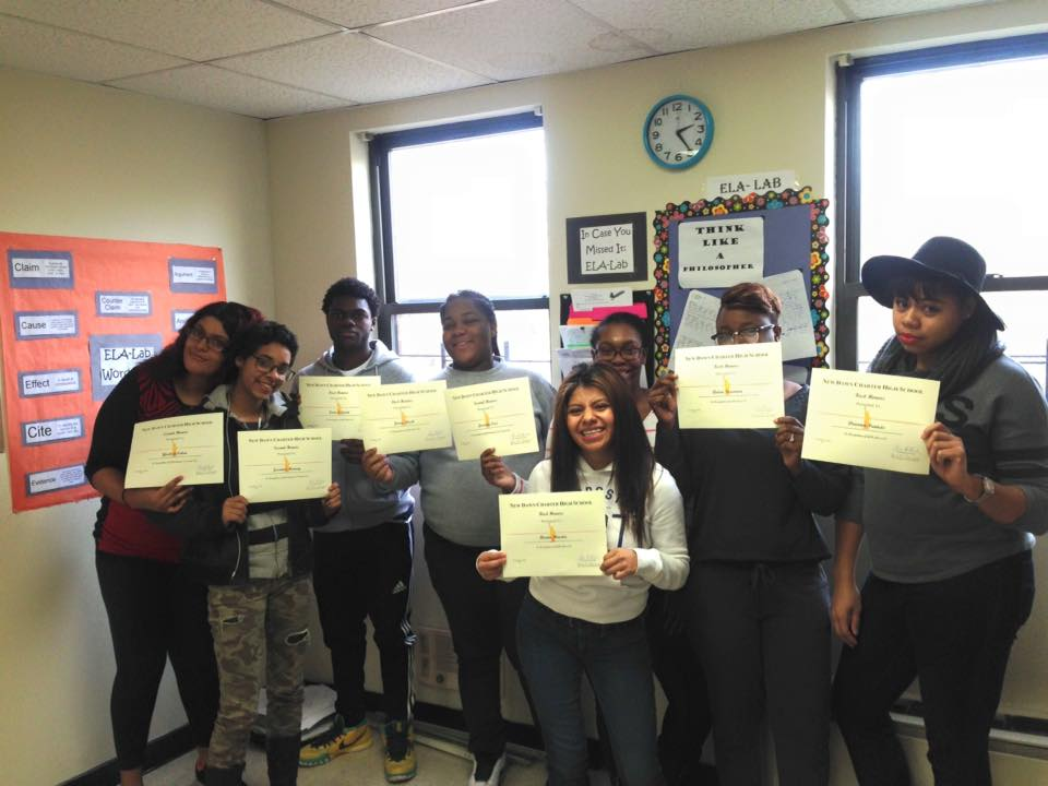 Students holding their award certificates