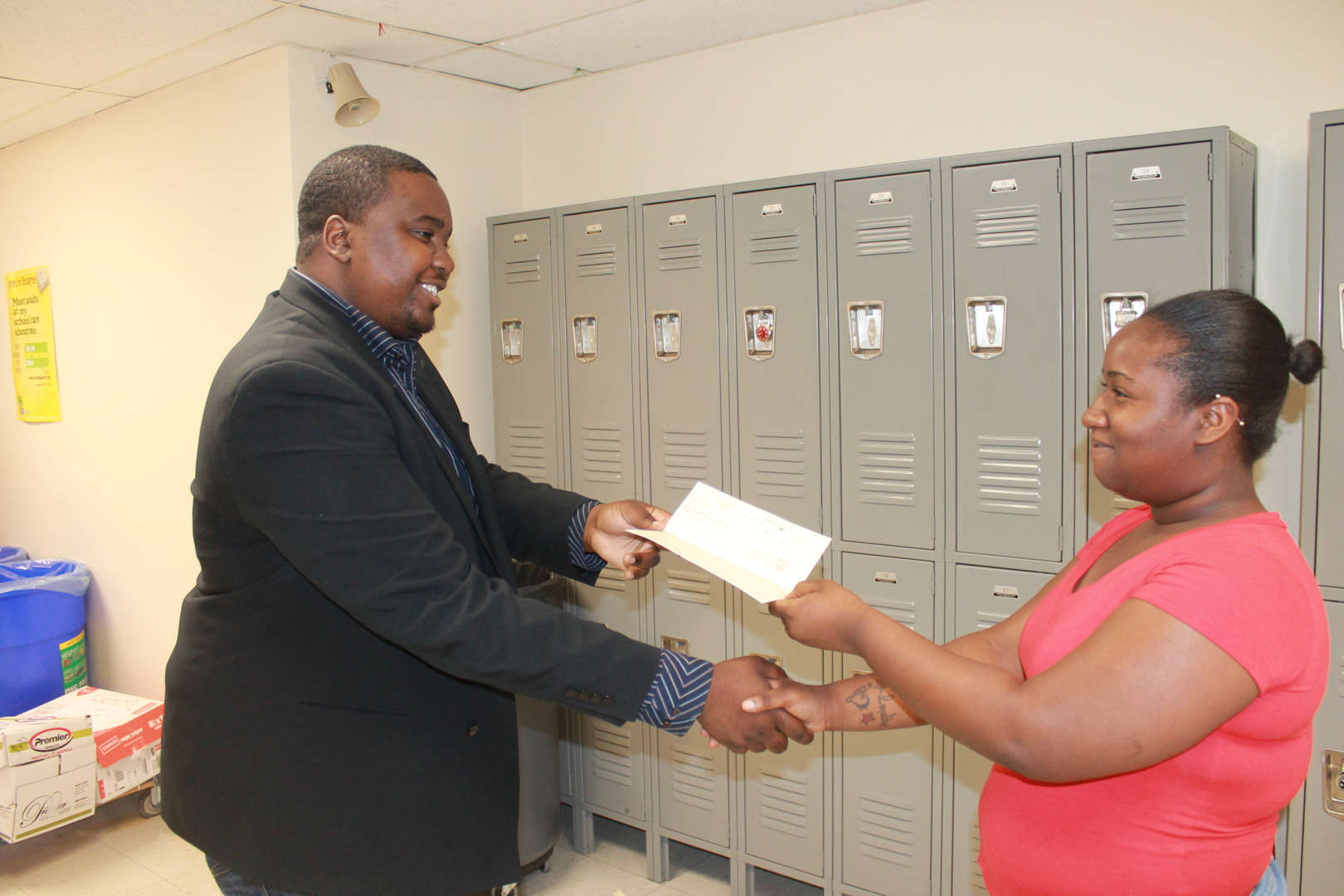 Man giving woman a check