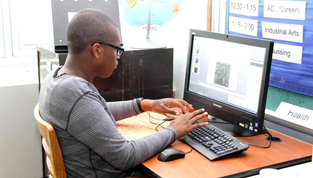 Student using a desktop computer in a classroom