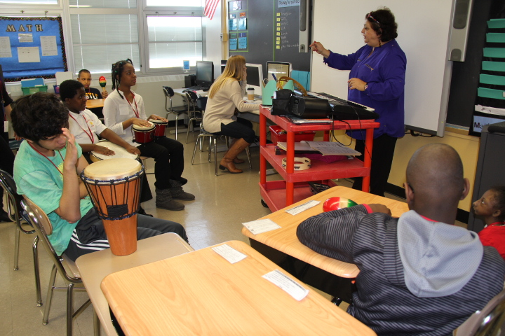 Students in music class using different instruments