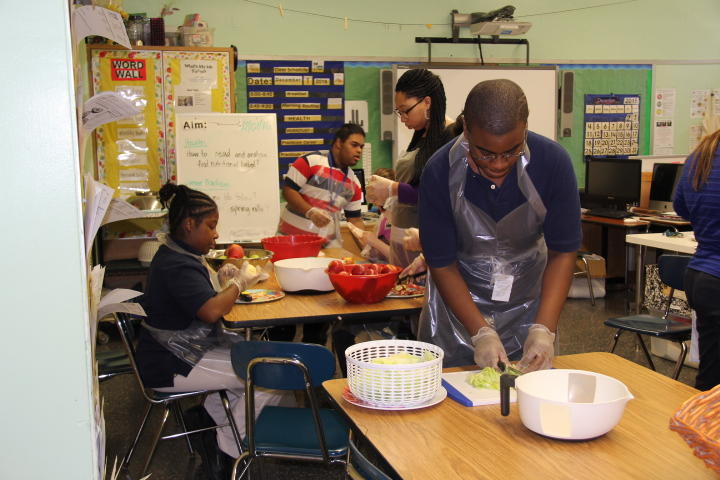 Students in cooking class preparing food