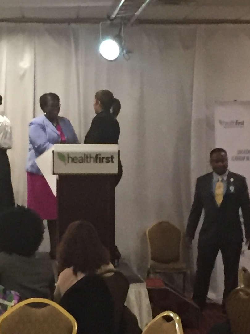 Principal Rose receiving a citation award