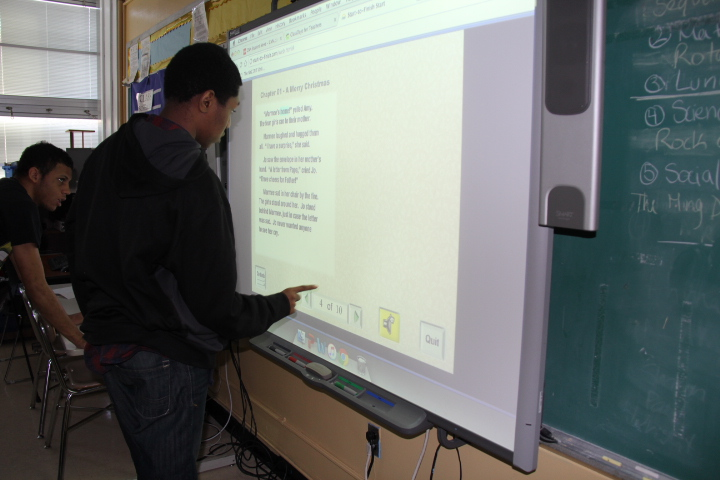 Student using a smartboard
