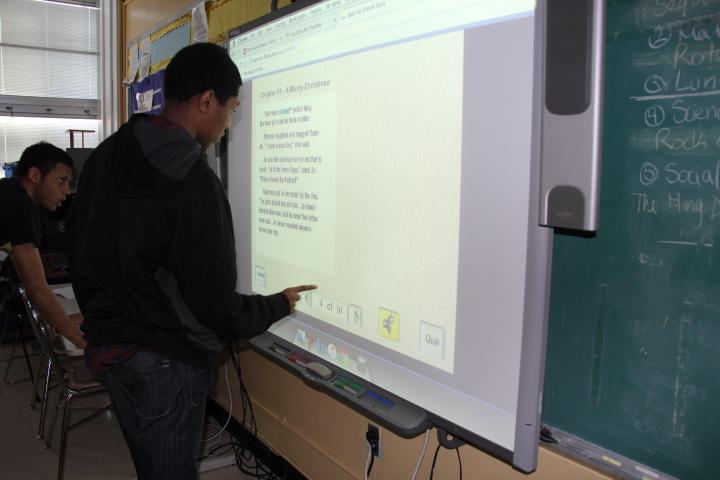 Student using a smartboard