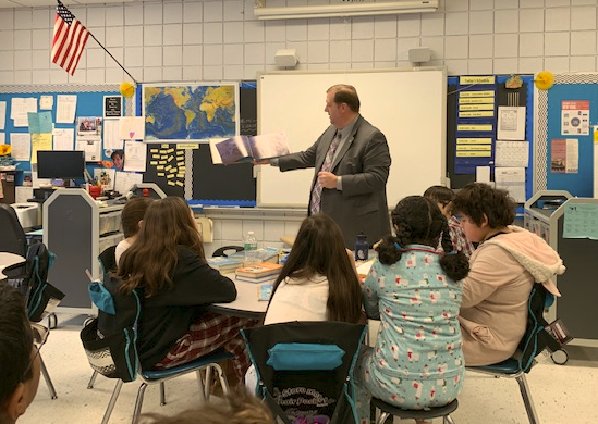 Clarkstown Supervisor, George Hoehmann reads to students