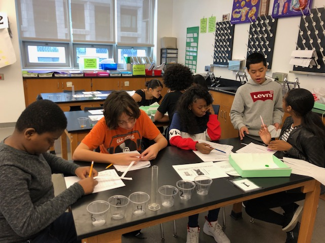 Students working in science classroom