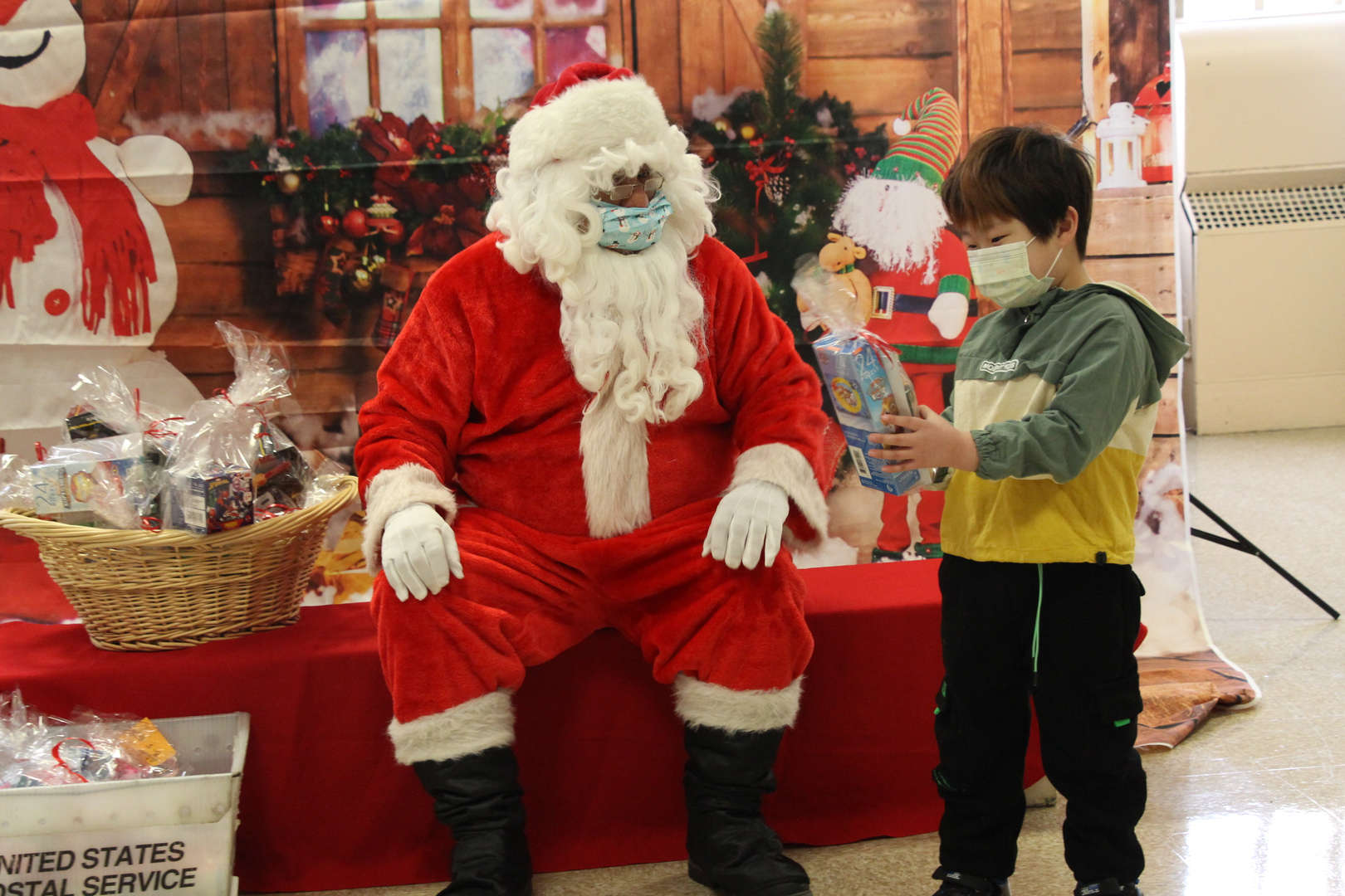 Santa makes a young boy very happy with his present.