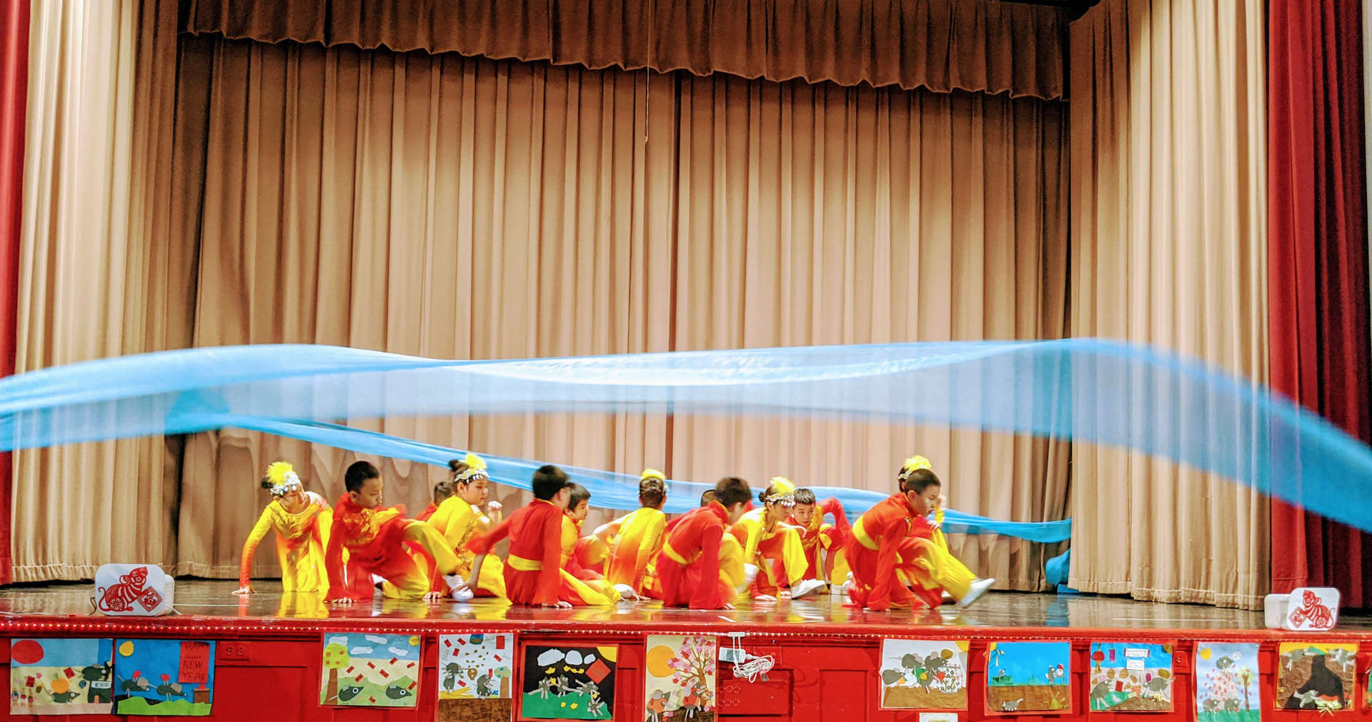 Students perform the lotus flower dance.
