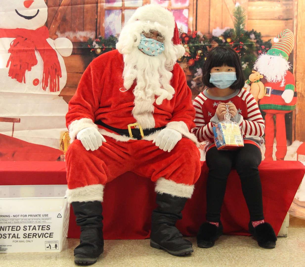 Santa loves giving students presents.
