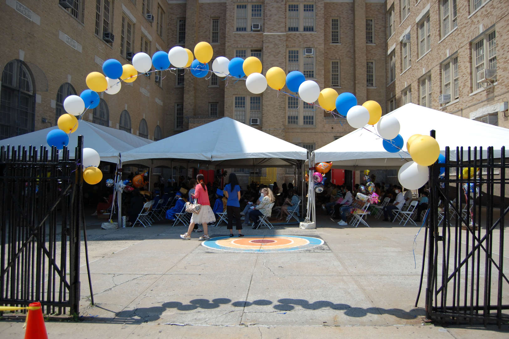A picture of graduation tents and balloons.